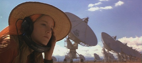 A hopeful Dr Ellie Arroway (Jodi Foster) listens for ET in the film adaption of the novel 'Contact'.  Copyright Warner Bros.  1997