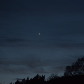 Slender waxing crescent Moon above Inverness