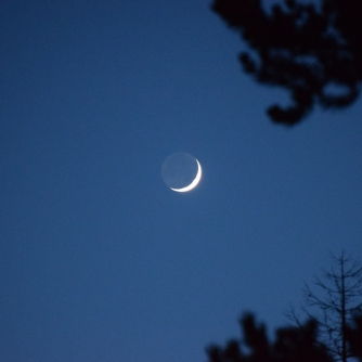 Waxing crescent Moon with earthshine above Abriachan